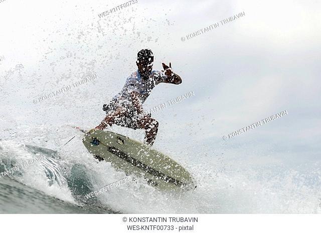 Indonesia, Java, man surfing