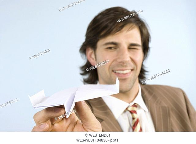 Man holding paper airplane