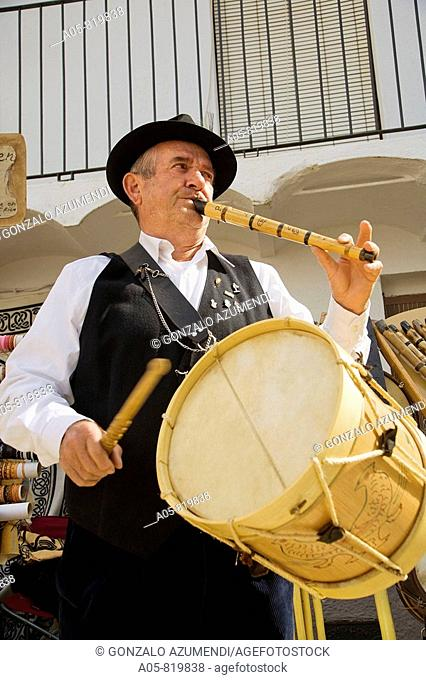 Man playing drum and Galician bagpipe during the Cerezo en flor festival, Casas del Castañar. Jerte river valley, Caceres province, Extremadura, Spain