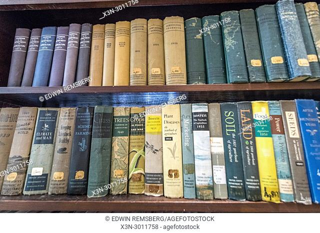 Book shelves stocked with vintage agriculture text books