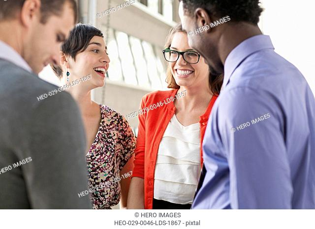 four young business people meeting in office