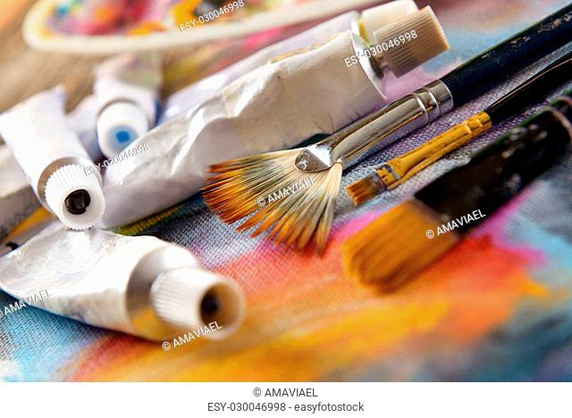 Professional acrylics paints with artistic brushes on canvas