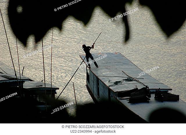Luang Prabang, Laos: boatman at work along the Nam Khan river
