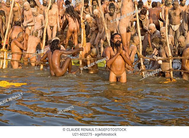A Nagababa from the Juna akhara praying in the Ganges during his holy bath during the Ardh Kumbh Mela in Allahabad