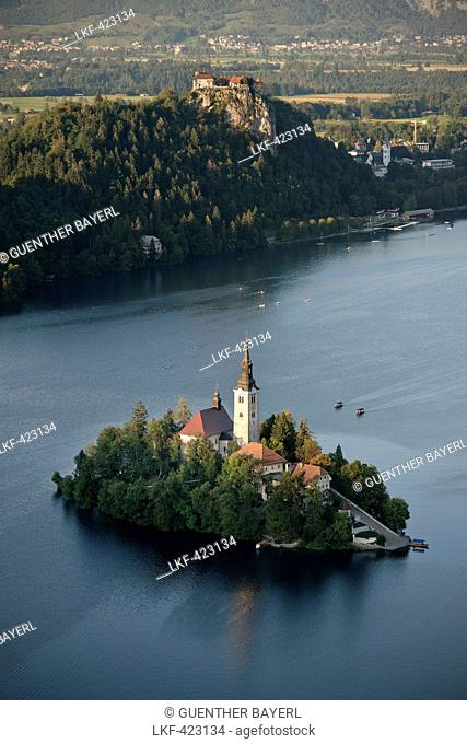 View at St. Mary Church at tiny island of Lake Bled, castle, Osojnica viewpoint, Julian Alps, Gorenjska, Slovenia