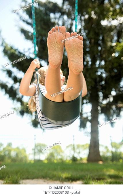USA, Pennsylvania, Washington Crossing, Girl (2-3) swinging on swing