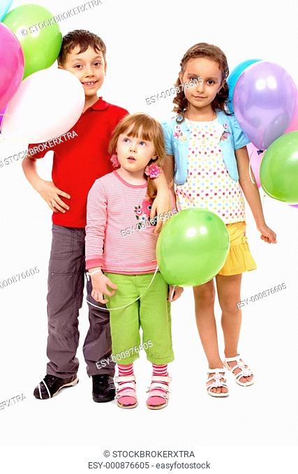 Portrait of kids with colorful balloons at birthday party
