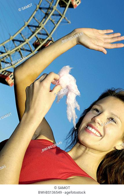 amusement park Prater Vienna, young woman with candy floss, Austria, Vienna