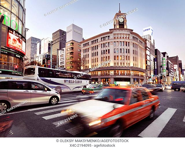 Rush hour city traffic on Chuo Dori street in front of Wako Department Store building in Ginza, Tokyo, Japan 2014