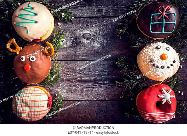 Christmas decoration on donuts,wooden background with blank space in the middle