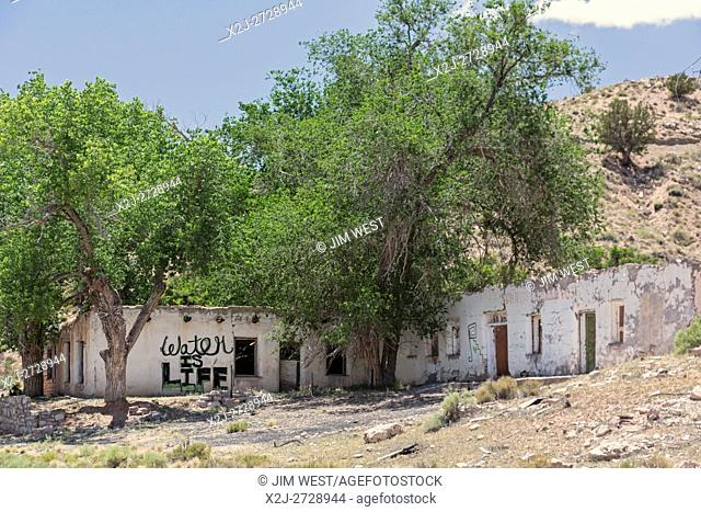 """Sunrise Springs, Arizona - An abandoned building on the Navajo reservation carries the slogan, """"""""Water is Life. """""""" Nearly 40% of the reservation's residents..."""