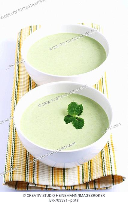 Pea cream soup garnished with mint