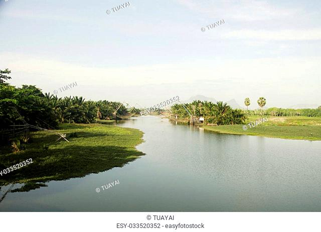 View landscape of fishing lift and dip net machine in canal at Ban Pak Pra fishing village in Phatthalung province of southern Thailand