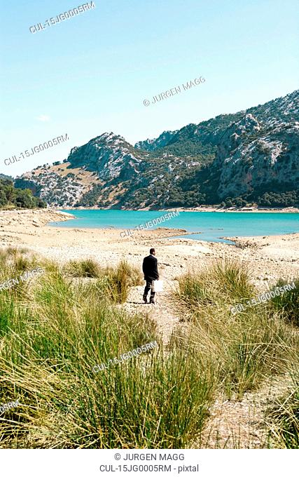 Business man walking by a lake