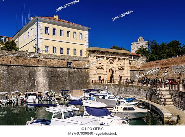 Croatia, Dalmatia, Zadar, fishing port Fosa, city wall and Kopnena vrata / Landward Gate with Lion of Saint Mark