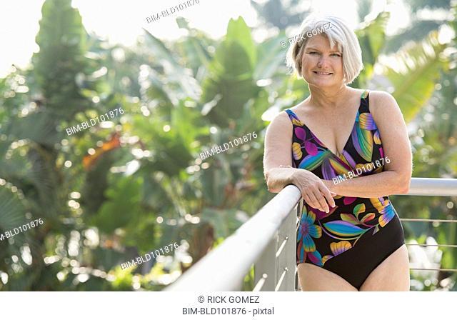 Caucasian woman standing in bathing suit
