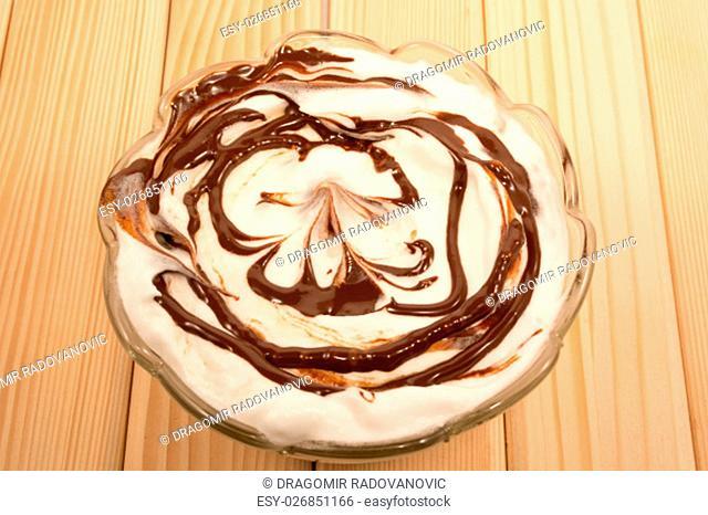 Vanila and chocolate desert in glass pot
