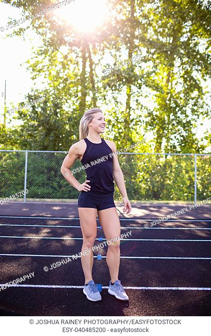 Portrait of a young female athlete on an outdoor track in Oregon