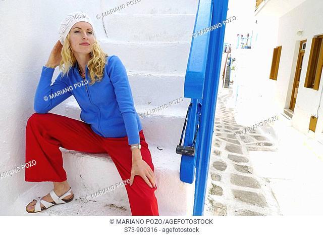30 year old woman in a Mykonos street, Cyclades Islands, Greece, Europe
