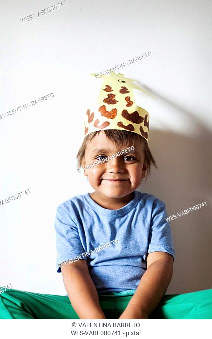 Portrait of smiling little boy wearing self-made headdress