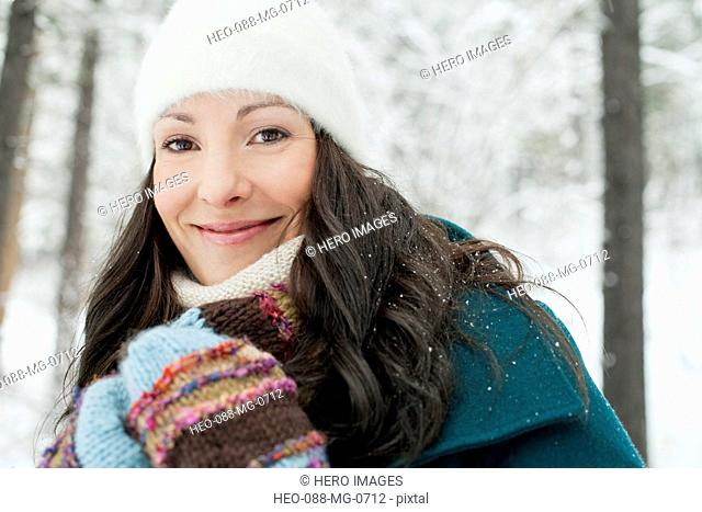 pretty adult woman in snowy countryside