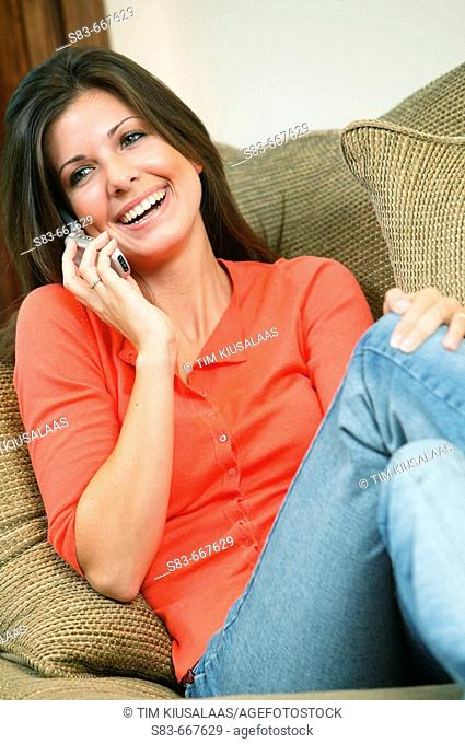 Girl sitting on couch talking on the phone