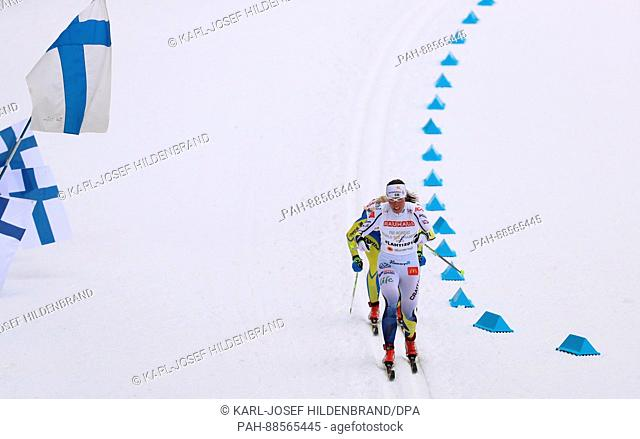 Charlotte Kalla from Sweden and Tetyana Antypenko (hidden) from Ukraine in action in the women's 10km cross country event at the Nordic Ski World Championship...