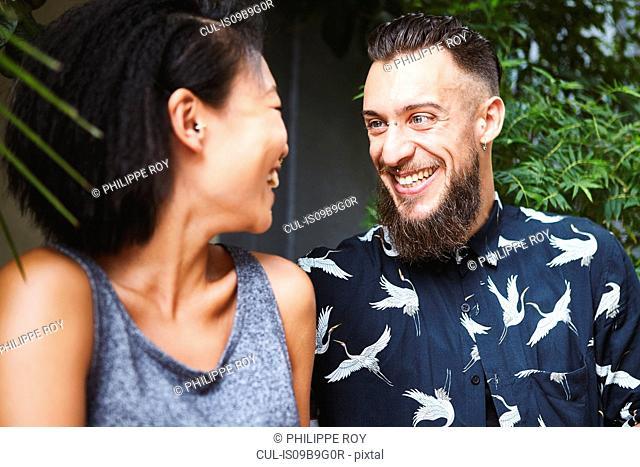 Multi ethnic couple laughing, Shanghai French Concession, Shanghai, China