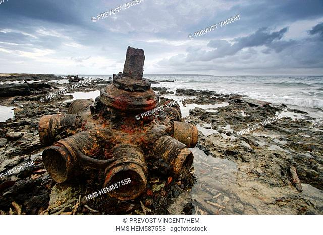Vanuatu, Sanma Province, Espiritu Santo Island, Luganville, Million Dollar Point, wreckage of an airplane engine at the seaside