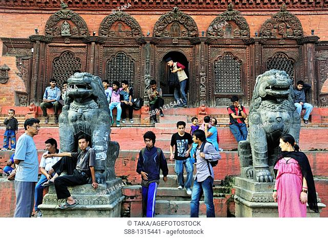 In front of the Shiva Parvati temple all day long people are there at Durbar Square in Hanuman Dhoka Durbar world heritage monument zone