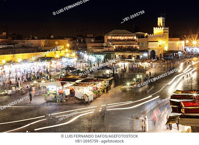 Hustle and bustle at night in Djemaa el Fna square, Marrakesh, Morocco
