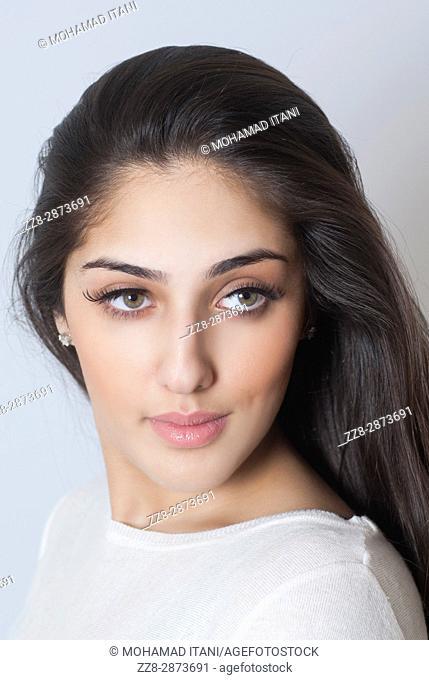 Beautiful Indian woman looking away thinking
