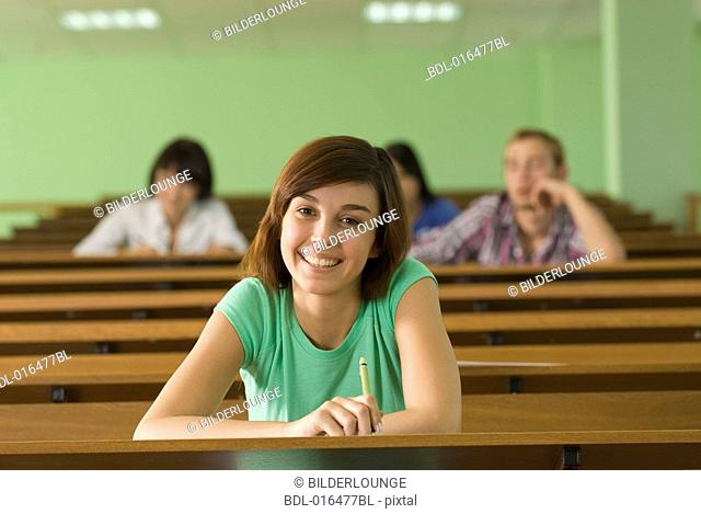 portrait of smiling young student in lecture hall