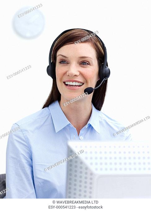 Laughing businesswoman with headset on against white background