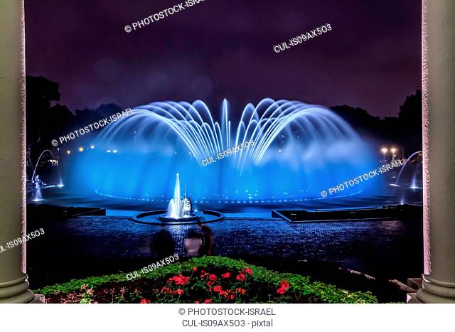 Blue illuminated fountain at night, Park of the Reserve (Parque de la Reserva), Lima, Peru