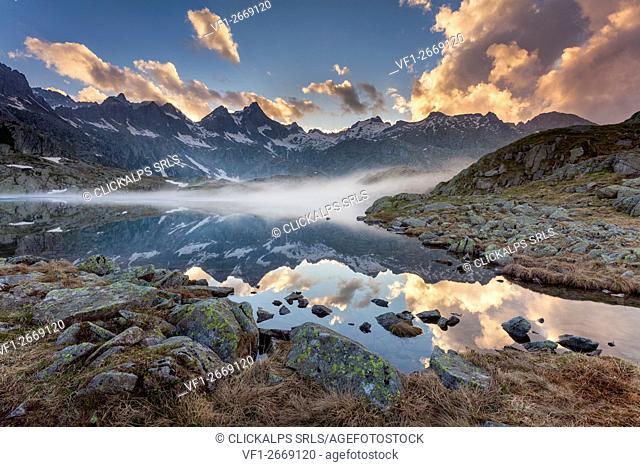 Lago Nero, Adamello-Brenta geopark, Trentino-Alto Adige, Italy. A sunset at Black lake into the Adamello-Brenta natural park