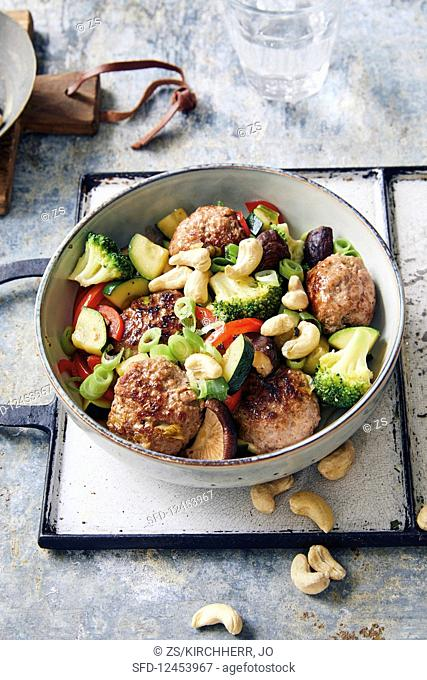 Meatballs with teriyaki vegetables and cashew nuts