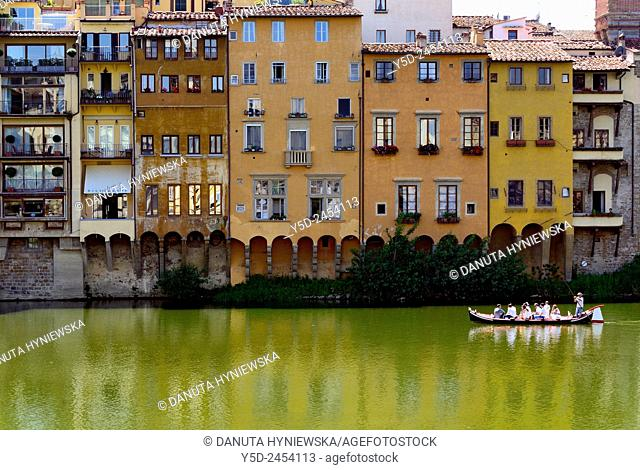 architecture along Arno river and tourist boat on Arno, Florence, Tuscany, Italy