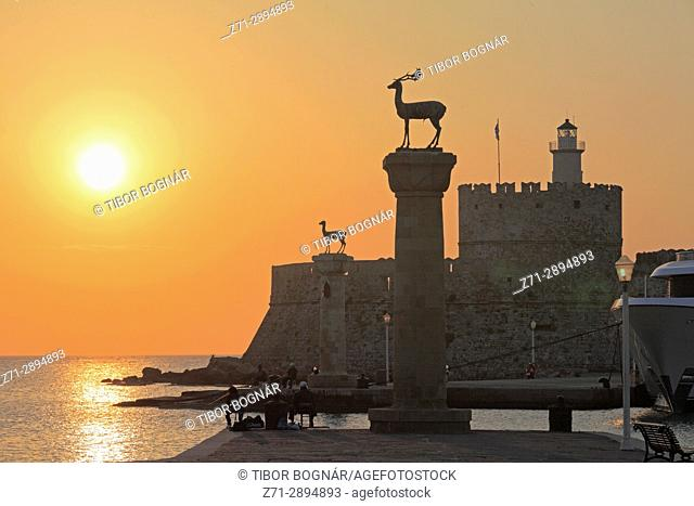 Greece, Dodecanese, Rhodes, Mandraki Harbour, Tower of St Nicholas, sunrise,