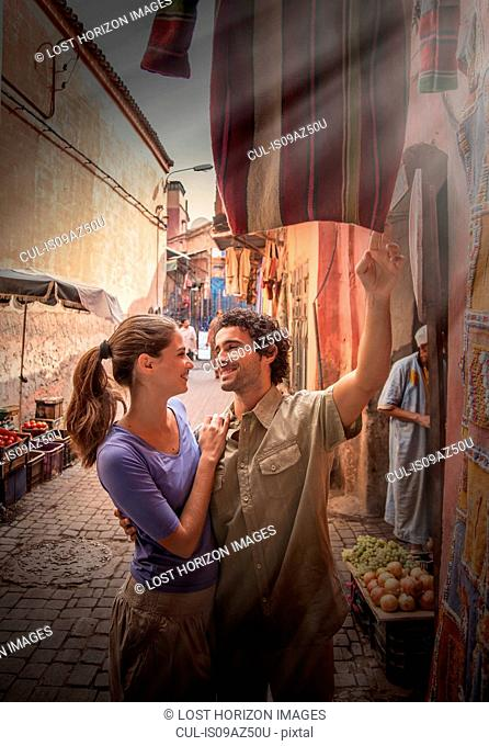 Young couple at market, Jemaa el-Fnaa Square, Marrakesh, Morocco