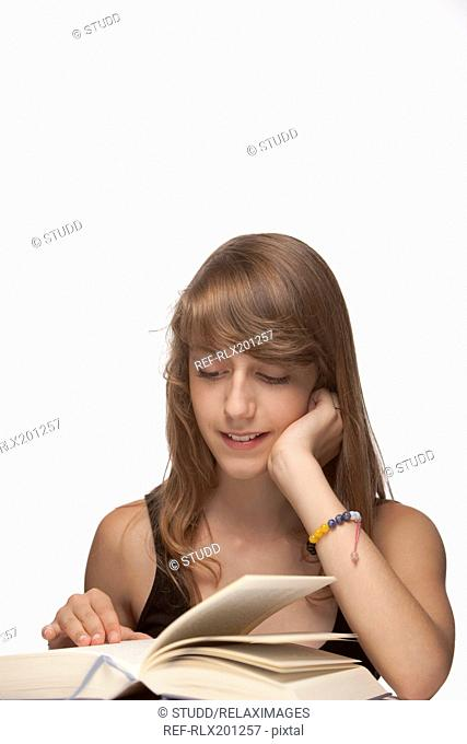 Girl book reading concentrating learning smiling