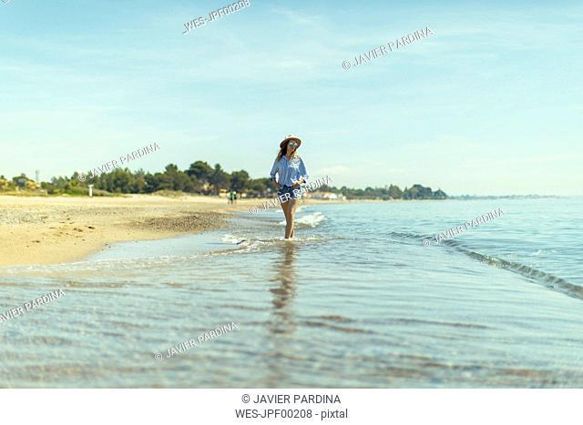 Woman walking at seaside