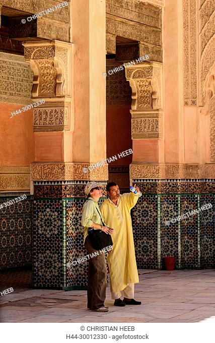 Morocco, Marrakesh, Medina, Medersa Ben Youssef Madrasa, woman and her local guide MR, Africa, Maghreb