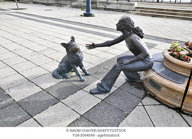 Girl with her dog, street bronze sculpture, Vigado Square, Hungary, Budapest, Europe,