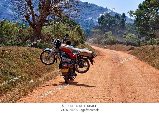 motorcycle transportation on gravel road in Uganda, Africa - Uganda, 11/02/2015