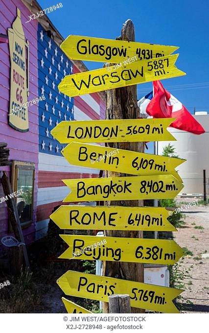 Seligman, Arizona - Souvenir shops and other tourist attractions line US Route 66, along with signposts pointing to far-away cities