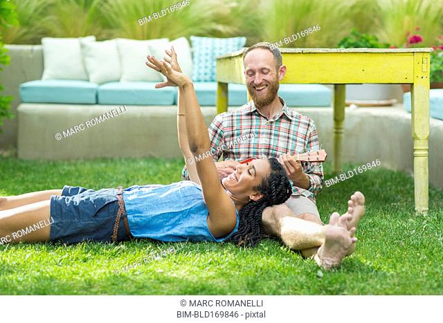 Couple relaxing in backyard