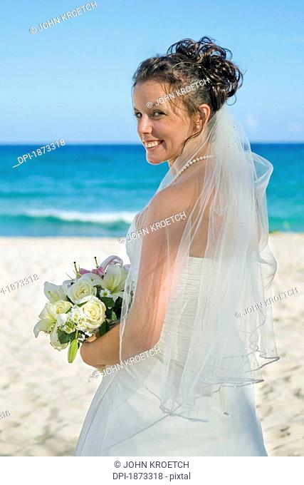 mayan riviera, akumal, mexico, a bride on the beach at gran bahia principe tulum all-inclusive resort
