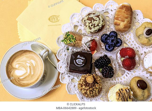 Cappuccino with typical sweets and pastries in the old Cafe Cova icon of Milan Lombardy Italy Europe