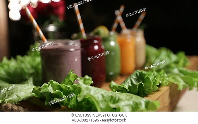 Jars of various smoothies with straws for dieting
